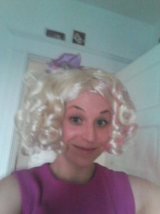 See? I REALLY love my job because I'll dress up like Effie Trinket for a Hunger Games program then post terrible selfies on the Internet to prove I did it. (I'll have someone at the library take a better picture tonight....)