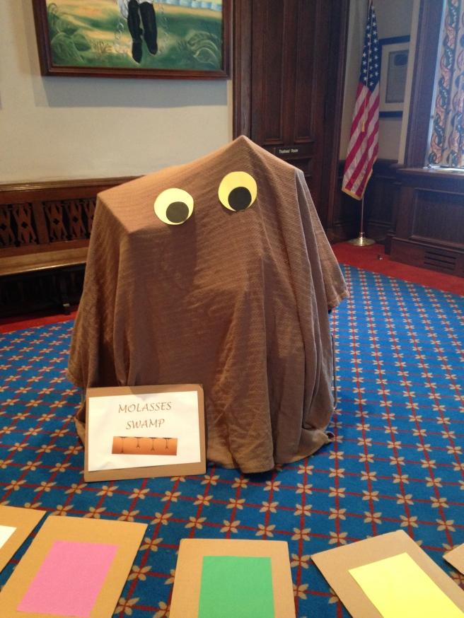 Made with boxes, chairs, an old brown blanket, and construction paper eyes. Easy peasy.